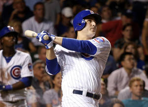 Photo - Chicago Cubs' Anthony Rizzo watches his two-run home run off Washington Nationals starting pitcher Ross Ohlendorf during the fifth inning of a baseball game on Wednesday, Aug. 21, 2013, in Chicago. (AP Photo/Charles Rex Arbogast)