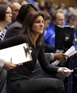 Photo - Virginia head coach Joanne Boyle watches the first half of play during an NCAA women's college basketball game against Duke, Thursday, Jan. 16, 2014, in Durham, N.C. (AP Photo/Ted Richardson)