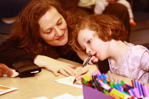 Photo - Jennifer Shaiman helps daughter Dorothy Cusack, 4, with a drawing Sunday during Family Day at the Fred Jones Jr. Museum of Art. PHOTOS BY LYNETTE LOBBAN, FOR THE OKLAHOMAN