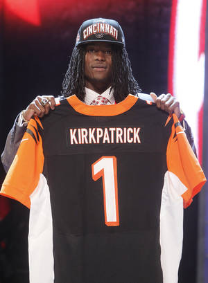 Photo -   Alabama cornerback Dre Kirkpatrick poses for photographs after being selected 17th overall by the Cincinnati Bengals in the first round of the NFL football draft at Radio City Music Hall, Thursday, April 26, 2012, in New York. (AP Photo/Jason DeCrow)