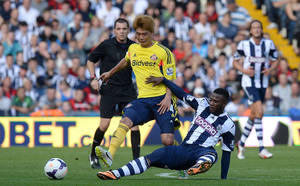 Photo - West Bromwich Albion's Stephane Sessegnon battles for the ball with Sunderland's Ki Sung Yeung during the English Premier League match at The Hawthorns, West Bromwich, England, Saturday Sept. 21, 2013. (AP Photo/ PA, Martin Rickett)UNITED KINGDOM OUT  NO SALES  NO ARCHIVE