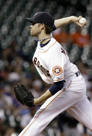 Photo - Houston Astros' Collin McHugh delivers a pitch against the Atlanta Braves in the first inning of a baseball game Wednesday, June 25, 2014, in Houston. (AP Photo/Pat Sullivan)