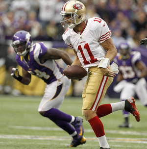Photo -   San Francisco 49ers quarterback Alex Smith (11) scrambles for yardage during the second half of an NFL football game against the Minnesota Vikings Sunday, Sept. 23, 2012, in Minneapolis. The Vikings won 24-13. (AP Photo/Genevieve Ross)