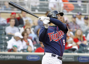 Photo - Minnesota Twins' Ryan Doumit watches the flight of his solo home run off Tampa Bay Rays relief pitcher Joel Peralta during the eighth inning of a baseball game in Minneapolis, Sunday, Sept. 15, 2013. The Twins won 6-4. (AP Photo/Ann Heisenfelt)