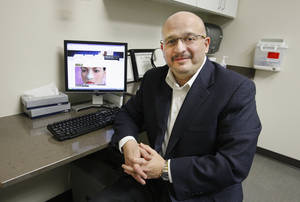 photo - Dr. Kamal Sawan, chief of plastic surgery at OU Physicians, performs rhinoplasty, or nose jobs, using an open technique. Sawan says this technique allows him a better visual on the patient's nose structure.  PHOTO BY PAUL B. SOUTHERLAND, THE OKLAHOMAN