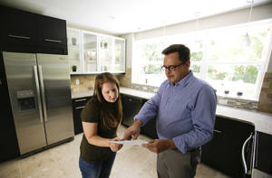 Photo - In this Friday, May 23, 2014 photo, realtor Greg Gammonley, right, with ConnectRealty.com, shows off a home to prospective buyer Maddie Coker in Orlando, Fla. A new report released Wednesday, July 16, 2014 by Trulia, the online real estate firm, suggests that the recession — for all its damage to the economy — did little to turn off millennials from the idea of owning a home compared to previous generations. (AP Photo/John Raoux)