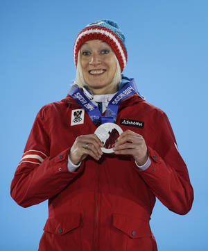 Photo - Women's normal hill ski jumping silver medalist Daniela Iraschko-Stolz of Austria smiles during the medals ceremony at the 2014 Winter Olympics, Wednesday, Feb. 12, 2014, in Sochi, Russia. (AP Photo/Morry Gash)