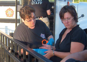 Photo - Sherry Littlebird awaits transport to jail. Photo provided