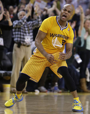 Photo - Golden State Warriors' Jarrett Jack reacts after scoring against the San Antonio Spurs during the second half of an NBA basketball game Friday, Feb. 22, 2013, in Oakland, Calif. (AP Photo/Ben Margot)