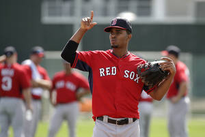 Photo - Boston Red Sox shortstop Xander Bogaerts works out on the field during spring training baseball practice Thursday, Feb. 20, 2014, in Fort Myers, Fla. (AP Photo/Steven Senne)