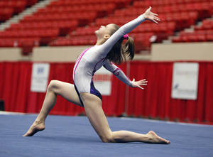 photo - Abbey Thompson with Victory Gymnastics competes in the floor exercise during the Nadia Comaneci International Invitational as part of the Bart & Nadia Sports & Health Festival l, at the Cox Convention Center in Oklahoma City, Sunday, Feb. 12, 2012. Photo by Sarah Phipps, The Oklahoman