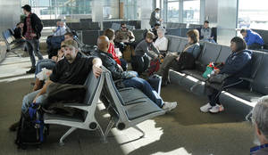 photo - Travelers wait for their flights at Will Rogers World Airport on Tuesday. Photo by PAUL HELLSTERN, The Oklahoman