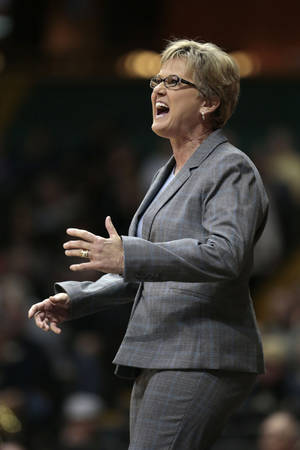 Photo - Tennessee head coach Holly Warlick yells to her players in the first half of an NCAA college basketball game against Vanderbilt, Sunday, Jan. 12, 2014, in Nashville, Tenn. (AP Photo/Mark Humphrey)