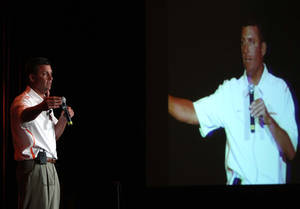 Photo - OSU football head coach Mike Gundy speaks to a crowd at the OSU caravan at the Renaissance Hotel in Tulsa, Okla. taken on August 1,2012. JAMES GIBBARD/Tulsa World