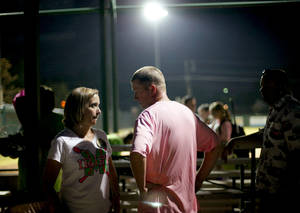 photo - WEAR / WEARING PINK / GIRLS HIGH SCHOOL SOFTBALL / KELLEY ALLEN: Volunteer coach Matt Allen talks with his wife Kelley after a Bishop McGuinness softball game in Oklahoma City, Tuesday, Sept. 14, 2011. Allen was diagnosed with brain cancer two years ago and continues his volunteer coaching duties with the softball team. Win-Win Week is a statewide effort by Oklahoma high schools to support cancer awareness. Photo by Bryan Terry, The Oklahoman ORG XMIT: KOD