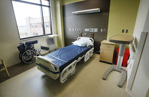 Photo - A patient room on the general rehabilitation floor at Mercy Rehabilitation Hospital, 5401 W Memorial Road. PHOTO BY PAUL B. SOUTHERLAND, THE OKLAHOMAN <strong>PAUL B. SOUTHERLAND - PAUL B. SOUTHERLAND</strong>