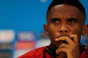Photo - Cameroon's Samuel Eto'o listens a question from the media during a news conference a day before the group A World Cup soccer match between Cameroon and Croatia at the Arena da Amazonia in Manaus, Brazil, Tuesday, June 17, 2014. (AP Photo/Fernando Llano)