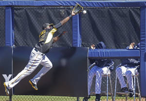 Photo - Pittsburgh Pirates right fielder Gregory Polanco (62) chases the ball on a triple hit by Tampa Bay Rays Logan Forsythe in the first inning of a exhibition baseball game in Port Charlotte, Fla., Saturday, March 8, 2014. (AP Photo/Gerald Herbert)