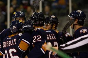 photo - Barons players celebrate a goal by Taylor Hall, center, during Thursday, Dec. 27 game against the Texas Stars. PHOTO BY JOSH RASMUSSEN, TEXAS STARS