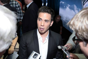 Photo - This publicity image released by NBC shows Apolo Ohno  speaking to the media at the NBC Olympics  session during the NBCUniversal Press Tour in Beverly Hills, Calif., on Saturday, July 27, 2013.  (AP Photo/NBC, Chris Haston)