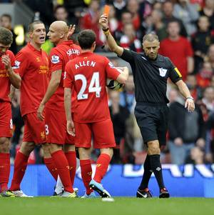 Photo -   Referee Mark Halsey, right, gives Liverpool's Jonjo Shelvey, second left, a red card during their English Premier League soccer match at Anfield in Liverpool, England, Sunday Sept. 23, 2012. (AP Photo/Clint Hughes)