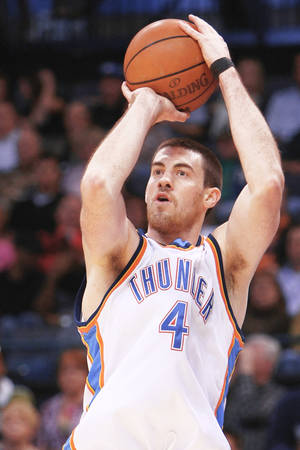 photo - Oklahoma City Thunder forward Nick Collison is an Iowa native, but loves to live in Seattle.  Photo by Hugh Scott, The Oklahoman