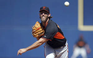 Photo - San Francisco Giants' Madison Bumgarner throws a pitch against the Milwaukee Brewers during the fifth inning of a spring training baseball game, Tuesday, March 25, 2014, in Phoenix. (AP Photo/Ross D. Franklin)