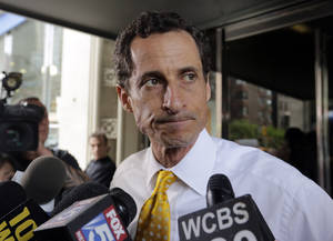 Photo - New York City mayoral candidate Anthony Weiner leaves his apartment building in New York on Wednesday, July 24, 2013. The former congressman acknowledged sending explicit text messages to a woman as recently as last summer, more than a year after sexting revelations destroyed his congressional career. (AP Photo/Richard Drew)