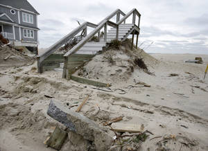 Photo - A stairway is all that is left Friday, Feb. 22, 2013, in the Normandy Beach section of Dover Township, N.J., of a home destroyed by Superstorm Sandy. (AP Photo/Mel Evans)
