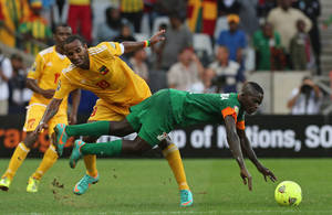 Photo - Zambia's Chisamba Lungu, right, is challenged by Ethiopia's captain Adane Girma, center, during their African Cup of Nations Group C soccer match at Mbombela Stadium in Nelspruit, South Africa, Monday Jan. 21, 2013. (AP Photo/Themba Hadebe)