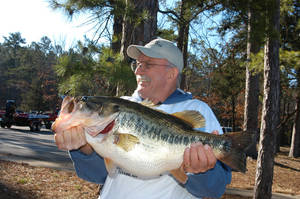 Photo -  Dale Miller of Panama caught the state record largemouth bass from Cedar Lake in Le Flore County on March 23 of last year. It was the second consecutive year that Cedar Lake produced the state largemouth record in March. Photo provided     <strong> -  Photo provided </strong>