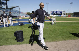Photo - New York Yankees shortstop Derek Jeter walks off the field after hitting during spring training baseball practice Thursday, Feb. 20, 2014, in Tampa, Fla. (AP Photo/Charlie Neibergall)