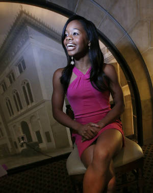 Photo - Gabby Douglas speaks to members of the media in Hartford, Conn., Friday, Aug. 16, 2013, before her induction into the USA Gymnastics Hall of Fame. (AP Photo/Elise Amendola)