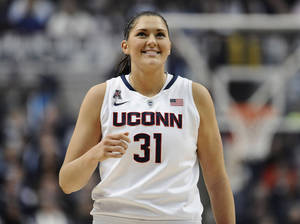 Photo - Connecticut's Stefanie Dolson smiles during the first half of an NCAA college basketball game against Rutgers, Saturday, March 1, 2014, in Storrs, Conn. (AP Photo/Jessica Hill)