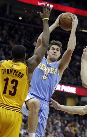 Photo - Denver Nuggets' Danilo Gallinari (8), from Italy, shoots over Cleveland Cavaliers' Tristan Thompson (13) in the first quarter of an NBA basketball game Saturday, Feb. 9, 2013, in Cleveland. (AP Photo/Mark Duncan)