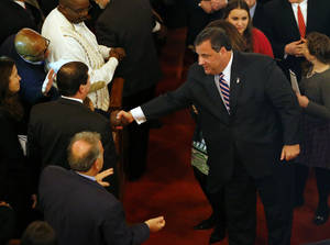 Photo - New Jersey Gov. Chris Christie shakes hands as he leaves a prayer service in celebration of his inauguration at the New Hope Baptist Church on Tuesday, Jan. 21, 2014 in Newark.  The celebrations to mark the start of Christie's second term could be tempered by investigations into traffic tie-ups that appear to have been ordered by his staff for political retribution and an allegation that his administration linked Superstorm Sandy aid to approval for a real estate project.  (AP Photo/Rich Schultz)