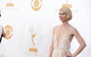Photo - Claire Danes, wearing Atelier Versace, arrives at the 65th Primetime Emmy Awards at Nokia Theatre on Sunday Sept. 22, 2013, in Los Angeles.  (Photo by Dan Steinberg/Invision/AP)