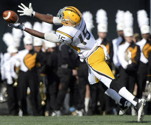 Photo - Southern Miss wide receiver James Cox dives but can't catch a pass in the second quarter against UAB in a NCAA football game at Legion Field in Birmingham, Ala., Saturday, Nov. 30, 2013.  (AP Photo/AL.com, Mark Almond) MAGS OUT