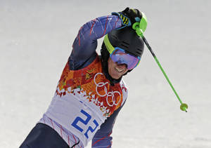 Photo - United States' Ted Ligety reacts after finishing the slalom portion of the men's supercombined at the Sochi 2014 Winter Olympics, Friday, Feb. 14, 2014, in Krasnaya Polyana, Russia. (AP Photo/Gero Breloer)