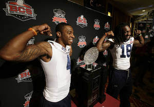 Photo - Auburn's Quan Bray (4) and Sammie Coates (18) pose with The Coaches' Trophy during media day for the NCAA BCS National Championship college football game Saturday, Jan. 4, 2014, in Newport Beach, Calif. Florida State plays Auburn on Monday, Jan. 6, 2014. (AP Photo/Chris Carlson)