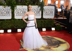 Photo - Jennifer Lawrence arrives at the 71st annual Golden Globe Awards at the Beverly Hilton Hotel on Sunday, Jan. 12, 2014, in Beverly Hills, Calif. (Photo by Jordan Strauss/Invision/AP)