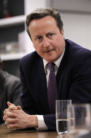 Photo -   FILE - In this Wednesday, April 4, 2012 file photo British Prime Minister David Cameron meets with social entrepreneurs at the Brigade as part of his launch of Big Society Capital, London. (AP Photo/Sang Tan, Pool, File)