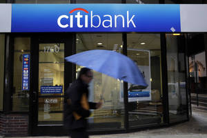 Photo - In this Jan. 14, 2014, photo,  a  person walks past a Citibank location in Philadelphia. Citigroup Inc. reports quarterly financial results before the market opens. on Thursday, Jan. 16, 2014. (AP Photo/Matt Rourke)