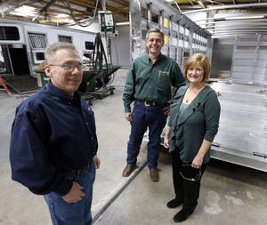 photo - Clif Cypert, left, human resources director, and Cimarron Trailers co-owners Mike and Lynn Terry are on the factory floor in Chickasha.  Photos by Steve Sisney, The Oklahoman