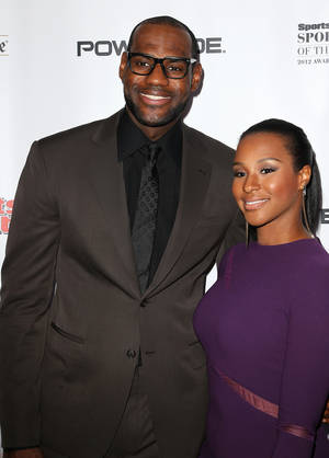 "Photo - LeBron James and Savannah Brinson attend the Sports Illustrated's ""Sportsman of the Year"" awards gala at Espace on Wednesday Dec. 5, 2012 in New York. (Photo By Donald Traill/Invision/AP)"