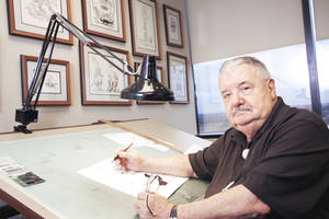 photo - Jim Lange, longtime  cartoonist at  The Oklahoman, is shown in his office Oct. 7. Lange died  Thursday at the age of 82.  PHOTO BY DOUG HOKE, THE OKLAHOMAN