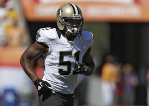 Photo -   New Orleans Saints linebacker Jonathan Vilma runs off the field after the coin flip before an NFL football game against the Tampa Bay Buccaneers Sunday, Oct. 21, 2012, in Tampa, Fla. (AP Photo/Chris O'Meara)