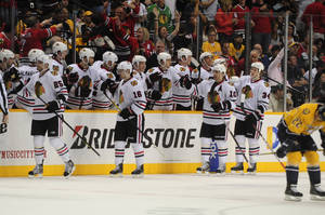photo -   The Chicago Blackhawks celebrate a goal by Chicago Blackhawks left wing Viktor Stalberg, left,, of Sweden, against the Nashville Predators in the second period of an NHL hockey game on Saturday, March 31, 2012, in Nashville, Tenn. (AP Photo/Mike Strasinger)