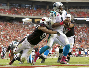 Photo - Carolina Panthers quarterback Cam Newton (1) is sacked in the end zone for a safety by Arizona Cardinals defensive end Calais Campbell (93) during the second half of a NFL football game, Sunday, Oct. 6, 2013, in Glendale, Ariz. (AP Photo/Ross D. Franklin)