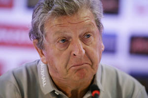 Photo - England national soccer team head coach Roy Hodgson pulls an expression as he speaks during a press conference after a squad training session that was closed to the media for the 2014 soccer World Cup at the Urca military base in Rio de Janeiro, Brazil, Sunday, June 22, 2014.  Costa Rica's surprise 1-0 win over Italy on Friday meant that England made its most humiliating exit from a World Cup since 1958, following consecutive defeats by the Italians and then Uruguay in Group D.  England play Costa Rica in their final Group D match on Tuesday.  (AP Photo/Matt Dunham)